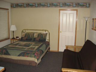 Main room with queen bed and double futon